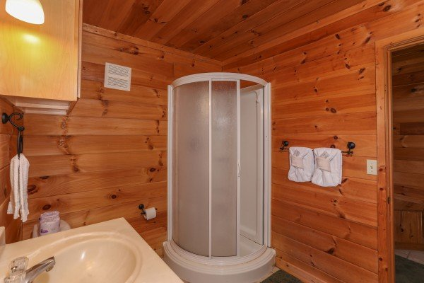 Separate shower in the bathroom at Hidden Ecstasy, a 1-bedroom cabin rental located in Pigeon Forge