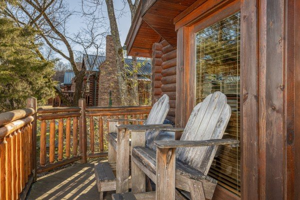 Adirondack chairs on a deck at Gone Fishin', a 2-bedroom cabin rental located in Pigeon Forge