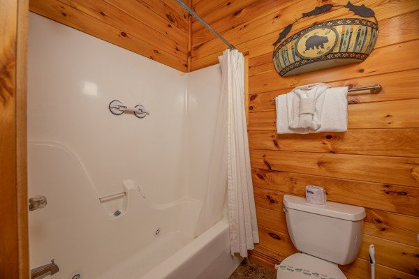 Bathroom with a tub and shower at Gone Fishin', a 2-bedroom cabin rental located in Pigeon Forge