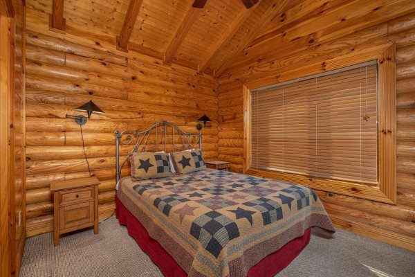 Bedroom with two night stands at Gone Fishin', a 2-bedroom cabin rental located in Pigeon Forge