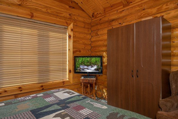 TV and armoire in a bedroom at Gone Fishin', a 2-bedroom cabin rental located in Pigeon Forge