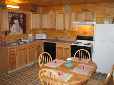 kitchen and table for four at dream catcher a 1 bedroom cabin rental located in pigeon forge