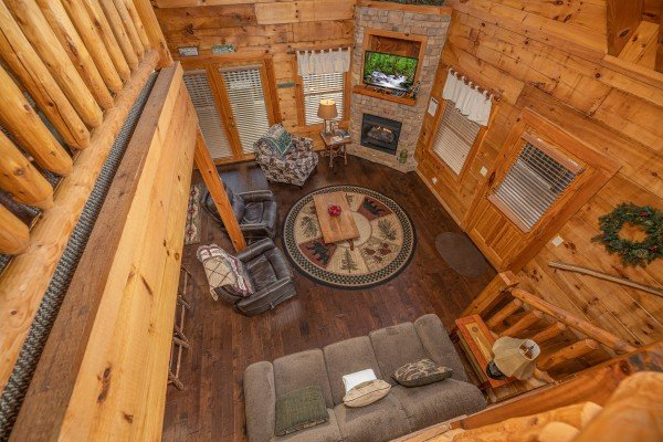 Looking down at the living room at Cold Creek Camp, a 3 bedroom cabin rental located in Pigeon Forge