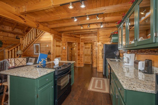 Breakfast bar in the kitchen at Cold Creek Camp, a 3 bedroom cabin rental located in Pigeon Forge