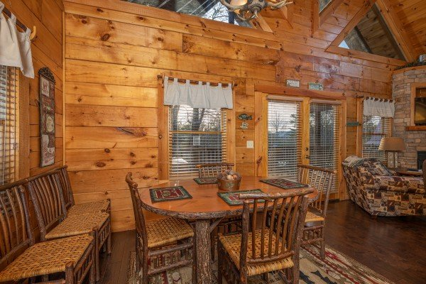 Dining space for four with additional chairs at Cold Creek Camp, a 3 bedroom cabin rental located in Pigeon Forge
