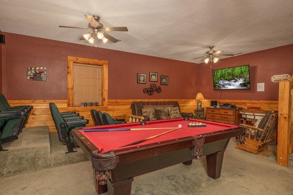 Game room with pool table and theater room with stadium seats at Cold Creek Camp, a 3 bedroom cabin rental located in Pigeon Forge
