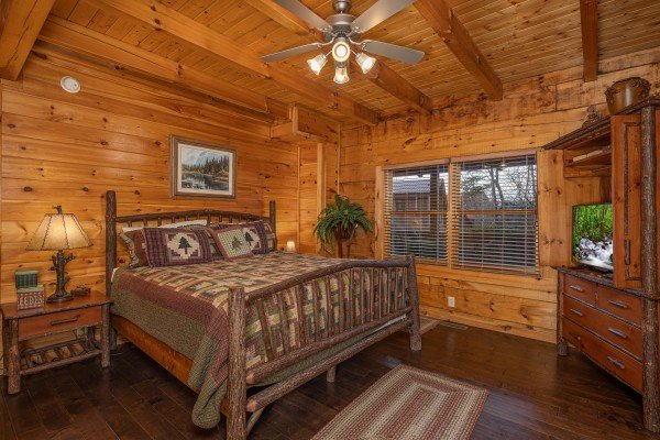 Bedroom with king bed, night stands, dresser, and TV at Cold Creek Camp, a 3 bedroom cabin rental located in Pigeon Forge