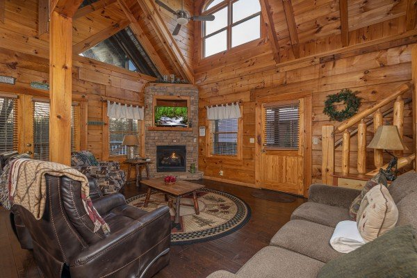 Living room with fireplace and TV at Cold Creek Camp, a 3 bedroom cabin rental located in Pigeon Forge