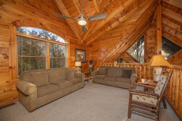 Loft with two sofas at Cold Creek Camp, a 3 bedroom cabin rental located in Pigeon Forge