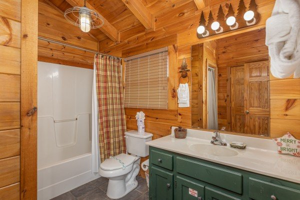 Bathroom with a tub and shower at Cold Creek Camp, a 3 bedroom cabin rental located in Pigeon Forge