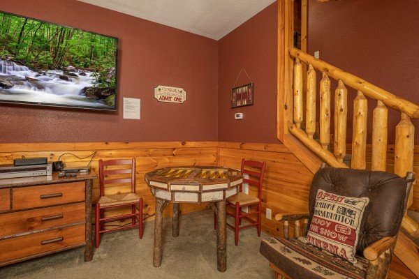 Table and chairs in the theater room at Cold Creek Camp, a 3 bedroom cabin rental located in Pigeon Forge