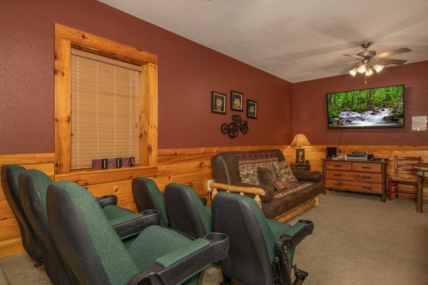Large TV and stadium seats in the theater room at Cold Creek Camp, a 3 bedroom cabin rental located in Pigeon Forge