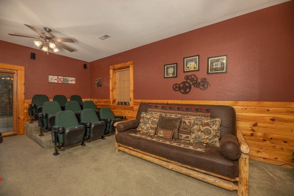 Movie seats and a futon at Cold Creek Camp, a 3 bedroom cabin rental located in Pigeon Forge
