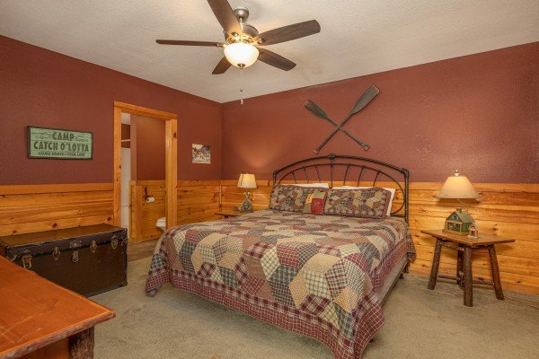 Bedroom with two night stands and lamps at Cold Creek Camp, a 3 bedroom cabin rental located in Pigeon Forge
