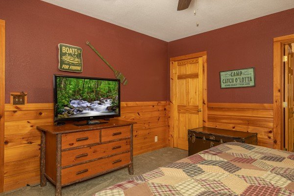 Dresser, TV, and chest in a bedroom at Cold Creek Camp, a 3 bedroom cabin rental located in Pigeon Forge