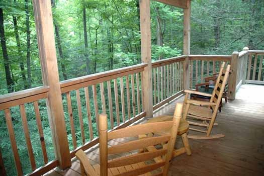 covered deck with chairs at a great escape a 1 bedroom cabin rental located in pigeon forge