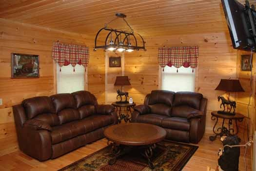 family room with sofa bed at a great escape a 1 bedroom cabin rental located in pigeon forge