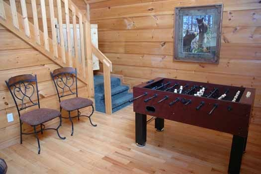 foosball table in living room at a great escape a 1 bedroom cabin rental located in pigeon forge