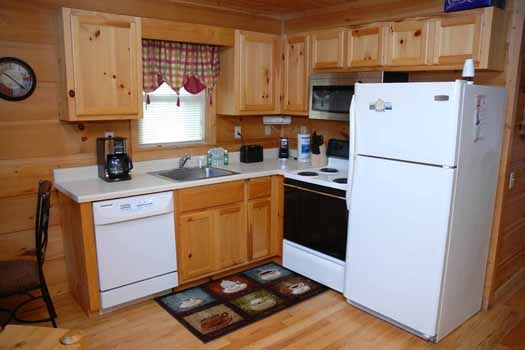 kitchen at a great escape a 1 bedroom cabin rental located in pigeon forge