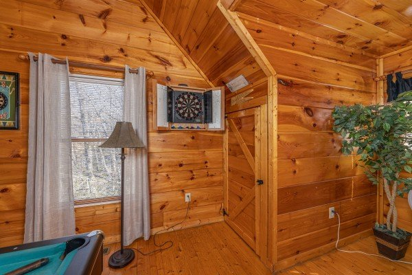 Dart board at Honey Bear Haven, a 1 bedroom cabin rental located in Pigeon Forge