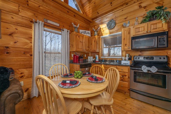 Dining table for four at Honey Bear Haven, a 1 bedroom cabin rental located in Pigeon Forge