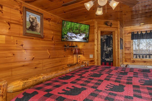 TV, jacuzzi, and bathroom at Honey Bear Haven, a 1 bedroom cabin rental located in Pigeon Forge