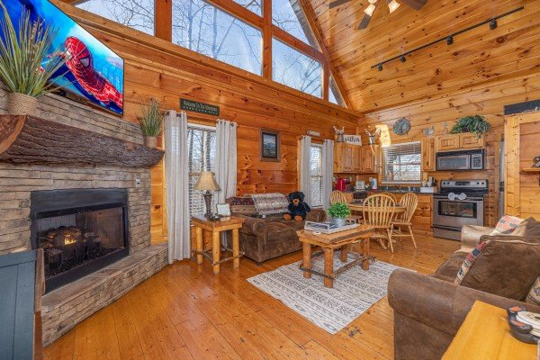 Living room with fireplace and TV at Honey Bear Haven, a 1 bedroom cabin rental located in Pigeon Forge