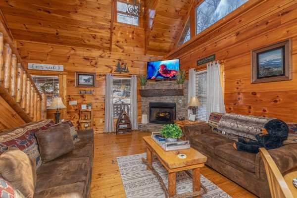 TV and fireplace in the living room at Honey Bear Haven, a 1 bedroom cabin rental located in Pigeon Forge