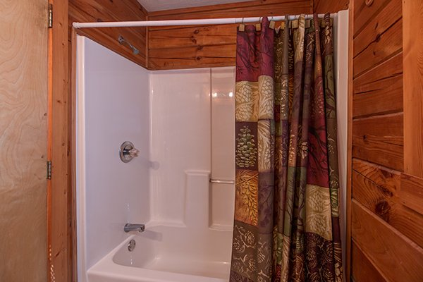Bathroom with a tub and shower at Mountain Garden, a 2 bedroom cabin rental located in Gatlinburg
