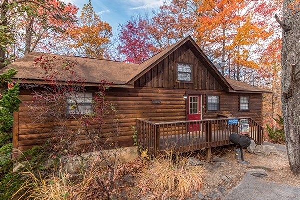 Cabin exterior and charcoal grill at Mountain Garden, a 2 bedroom cabin rental located in Gatlinburg