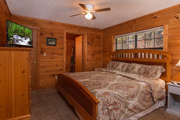 Bedroom with a king bed, dresser, and TV at Mountain Garden, a 2 bedroom cabin rental located in Gatlinburg