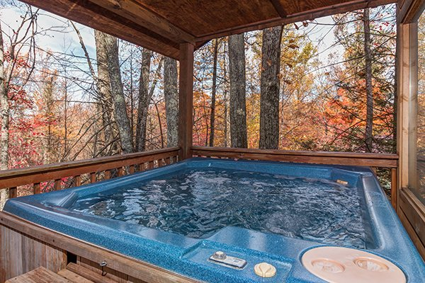 Hot tub on a covered deck at Mountain Garden, a 2 bedroom cabin rental located in Gatlinburg