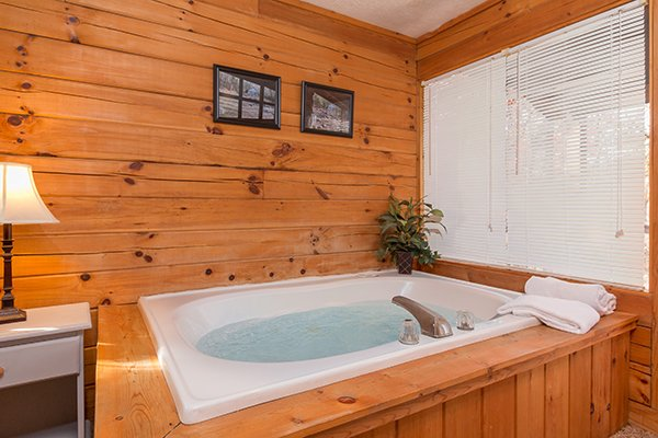Jacuzzi tub in a bedroom at Mountain Garden, a 2 bedroom cabin rental located in Gatlinburg
