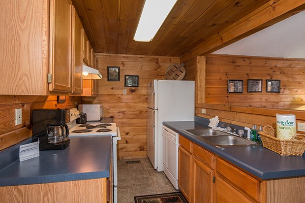 Kitchen with white appliances at Mountain Garden, a 2 bedroom cabin rental located in Gatlinburg