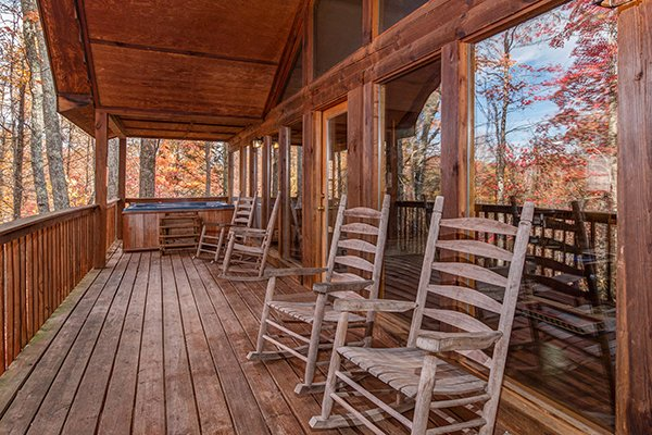 Rocking chairs on a covered deck at Mountain Garden, a 2 bedroom cabin rental located in Gatlinburg