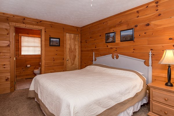Bedroom with a king sized bed at Mountain Garden, a 2 bedroom cabin rental located in Gatlinburg