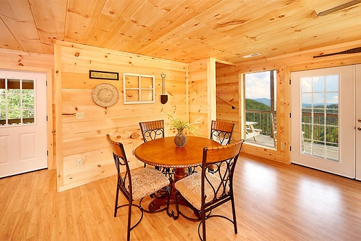 Dining table for four at A Perfect Getaway, a 3 bedroom cabin rental located in Pigeon Forge