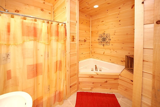 Jacuzzi tub in first floor bathroom at A Perfect Getaway, a 3 bedroom cabin rental located in Pigeon Forge