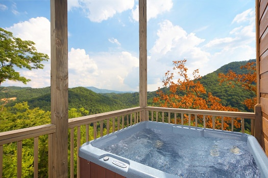 Enjoy the smoky mountain views from the hot tub at A Perfect Getaway, a 3 bedroom cabin rental located in Pigeon Forge
