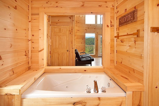 Jacuzzi tub in bathroom on third floor at A Perfect Getaway, a 3 bedroom cabin rental located in Pigeon Forge