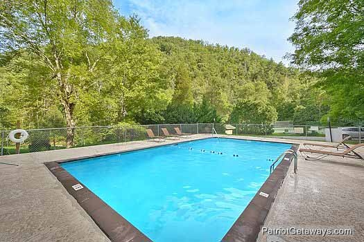 Swim in the resort pool at A Perfect Getaway, a 3 bedroom cabin rental located in Pigeon Forge