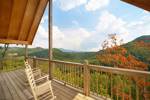 Enjoy the views from the covered deck on the third floor at A Perfect Getaway, a 3 bedroom cabin rental located in Pigeon Forge