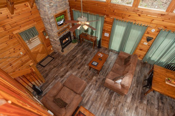 Looking down onto the main floor from the loft at Blackberry Delite, a 1-bedroom cabin rental located in Pigeon Forge