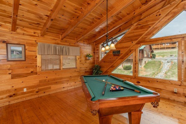 Pool table in the game loft at Blackberry Delite, a 1-bedroom cabin rental located in Pigeon Forge
