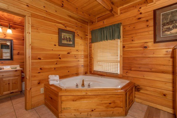 Jacuzzi in the corner of the bedroom at Blackberry Delite, a 1-bedroom cabin rental located in Pigeon Forge
