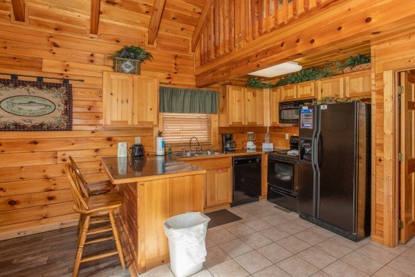 Kitchen and breakfast bar at Blackberry Delite, a 1-bedroom cabin rental located in Pigeon Forge