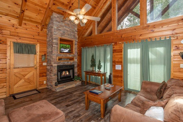 Fireplace and TV in the living room Blackberry Delite, a 1-bedroom cabin rental located in Pigeon Forge