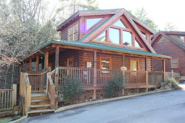 Looking at the cabin from the road at Blackberry Delite, a 1-bedroom cabin rental located in Pigeon Forge