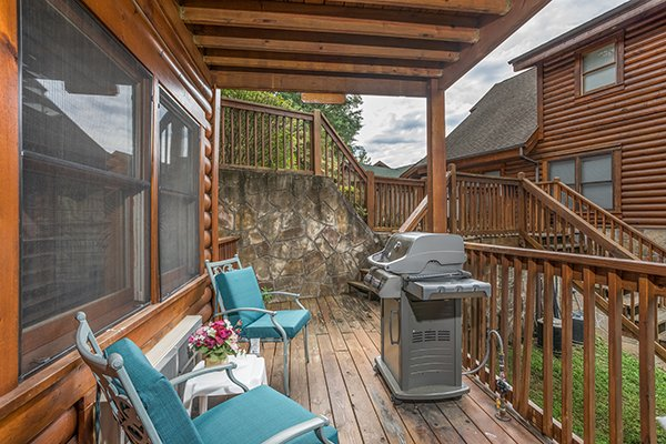 Deck with seating for two and a grill at Mountain Escape, a 2 bedroom cabin rental located in Pigeon Forge