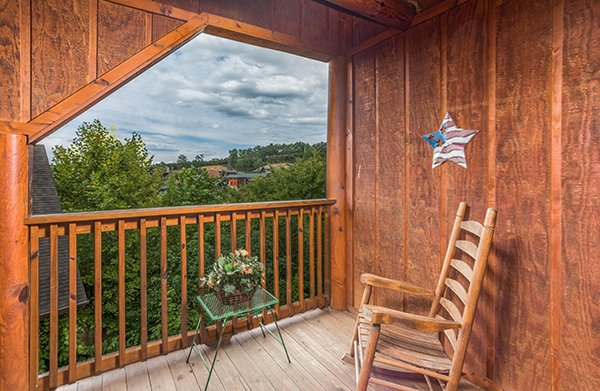 Covered deck with resort area views at Mountain Escape, a 2 bedroom cabin rental located in Pigeon Forge